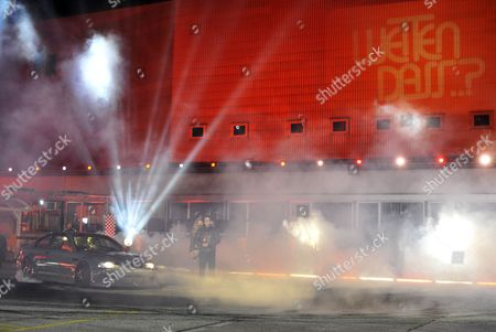 Austrian Tv Presenter Mirjam Weichselbraun (c-l) and German Betting Candidate Joerg Soehner (c-r) who Tried to Identify the Correct Tire-model by the Smell It Produces While Drifting Are Seen During the So-called 'Outside Bet' Within the German Tv Show 'Wetten Dass ?' ('bet That ') in Vienna Austria 23 March 2013 Austria Vienna