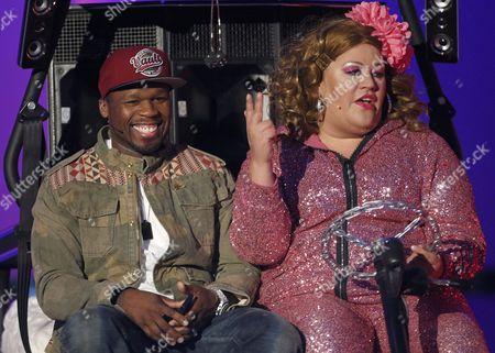 Us Rapper Curtis James Jackson Iii (l) Aka '50 Cent' and Show Assistent Cindy Aus Marzahn (r) Joke Around During the German Tv Show 'Wetten Dass ?' ('bet That ') in Vienna Austria 23 March 2013 Austria Vienna