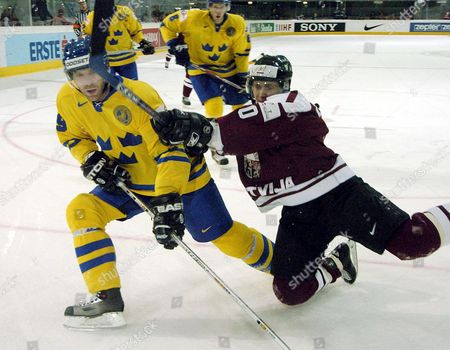 Peter Nordstrom of Sweden (l) Challenges For the Puck with Maris Ziedins of Latvia During Their Ice Hockey World Championships Match Agaist Latvia in Innsbruck Austria Tuesday 10 May 2005 Austria Innsbruck