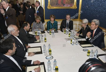 Iranian Foreign Minister Javad Zarif (2-l) the European Union's Negotiator Catherine Ashton (c) and Us Secretary of State John Kerry (r) Sit at a Conference Table Prior to Their Talks Between the E3+3 (france Germany Uk China Russia Us) and Iran in Vienna Austria 21 November 2014 Others Are not Identified High-level Negotiators Are Working on a Deal That Would Cut Back Tehran's Civilian Nuclear Programme and Reduce the Risk That It Could Be Used For Making Nuclear Weapons Kerry on 20 November Had Warned That the Six Powers Negotiating the Nuclear Deal with Iran Would not Be Rushed Into Closing an Agreement That Does not Meet Their Standards Austria Vienna