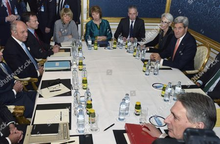 French Foreign Minister Laurent Fabius (l) the European Union's Negotiator Catherine Ashton (c) and Us Secretary of State John Kerry (r) and British Foreign Secretary Philip Hammond (bottom) Sit at a Conference Table Prior to Their Talks Between the E3+3 (france Germany Uk China Russia Us) and Iran in Vienna Austria 21 November 2014 Others Are not Identified High-level Negotiators Are Working on a Deal That Would Cut Back Tehran's Civilian Nuclear Programme and Reduce the Risk That It Could Be Used For Making Nuclear Weapons Kerry on 20 November Had Warned That the Six Powers Negotiating the Nuclear Deal with Iran Would not Be Rushed Into Closing an Agreement That Does not Meet Their Standards Austria Schwechat