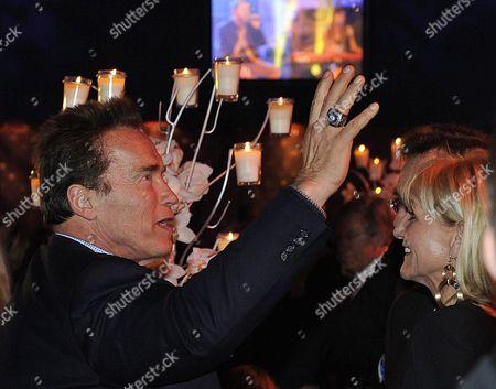 Former California Governor Arnold Schwarzenegger (left) and Skier Christa Kinshofer Attend the Kitz Race - Party in Kitzbuehel Austria 21 January 2012 Austria Kitzbühel