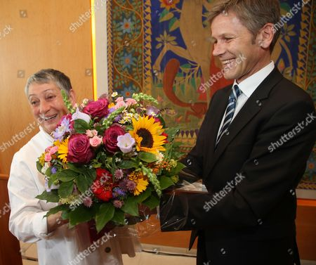 Russian Writer Lyudmila Ulitskaya (l) Receives the Austrian State Prize For European Literature 2014 and a Bouquet of Flowers From Austrian Minister For Cultural Affairs Josef Ostermayer (r) in Salzburg Austria 26 July 2014 the Literary Award Endowed with 25 00 Euros is Presented Annually by the Federal Ministry of Education and Art Since 1965 Austria Salzburg