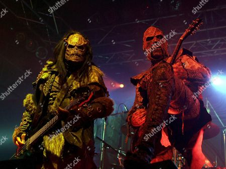 Bassist Ox (l) and Guitarist Amen (r) of the Finnish Rock Band Lordi Perform During a Concert on Wednesday 11 October 2006 in the Arena in Vienna Austria Vienna