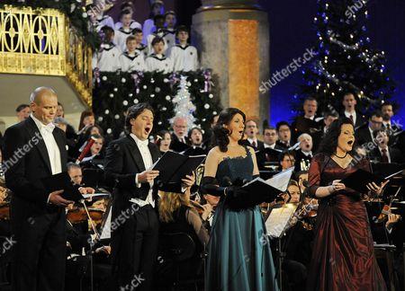 (l-r) Singers Bo Skovhus Dmitry Korchak Elisabeth Kulman and Genia Kuehmeier Perform During Rehearsals of the Concert 'Christmas in Vienna' in Vienna Austria 17 December 2010 Austria Vienna
