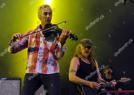 (l-r) Fiddler Jonathan Mark Sevink Guitarist Simon Friend and Keyboard Player Matt Savage of English Rock Band Levellers Performs on Stage During a Concert at the Forestglade in Wiesen Austria 16 July 2011 Austria Wiesen