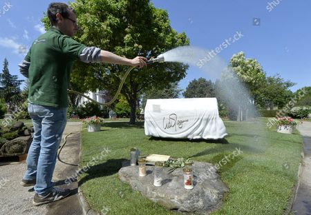 A Gardener Waters the Grass Next to the Tomb of Late Austrian Entertainer Udo Juergens at the Zentralfiedhof in Vienna Austria 08 May 2015 Juergens Died on 21 December 2014 in Switzerland Austria Vienna