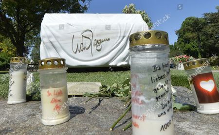 Candles Are Placed in Front of the Tomb of Late Austrian Entertainer Udo Juergens at the Zentralfiedhof in Vienna Austria 08 May 2015 Juergens Died on 21 December 2014 in Switzerland Austria Vienna