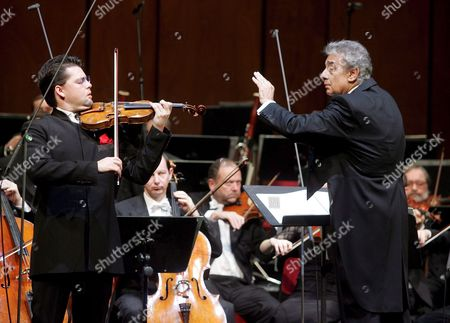 Musical Director of the Concert Placido Domingo (r) Conducts As Julian Rachlin (l) Plays the Violin During Dress Rehearsals of the Inauguration Concert to Mark the Opening of the New Opera House the 'Theater an Der Wien' in Vienna on Sunday 08 January 2005 Austria Vienna