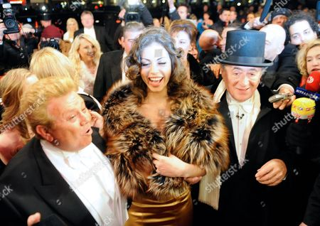 (l-r) Israeli Actor Zachi Noy Moroccan Karima El-marough Aka Ruby Rubacuore and Host Austrian Businessman Richard Lugner Arrive For the Vienna State Opera Ball 2011 in Vienna Austria 03 March 2011 the Traditional Vienna Opera Ball Takes Place on 03 March Austria Vienna