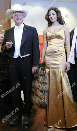 Us Actor Larry Hagman (l) Moroccan Karima El-marough Aka Ruby Rubacuore Host of Austrian Businessman Richard Lugner Pose For a Photograph at the Presentation of the Ball Gowns at the Vienna State Opera in Vienna Austria 03 March 2011 the Traditional Vienna Opera Ball Takes Place on 03 March Austria Vienna
