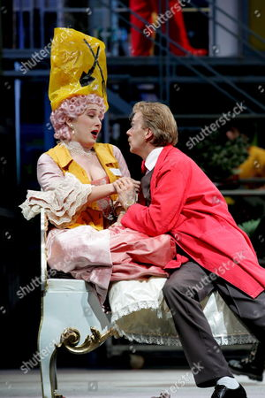 Stock Photo of Alexandra Reinprecht (l) As 'Violante' and John Grahan Hall As 'Podesta' Perform During a Photo Rehearsal of 'La Finta Giardiniera' ('die Gaertnerin Aus Liebe') by Giuseppe Petrosellini and Music by Wolfgang Amadeus Mozart Tuesday 17 January 2006 at the Landestheater in Salzburg Austria 'La Finta Giardiniera' Directed by Doris Doerrie Has Its Premier During the Mozart Week 2006 on Friday 20 January 2006 Marks the 250th Birthday of the Famous Composer Mozart Which Austria Will Celebrate with a Number of Events Austria Salzburg