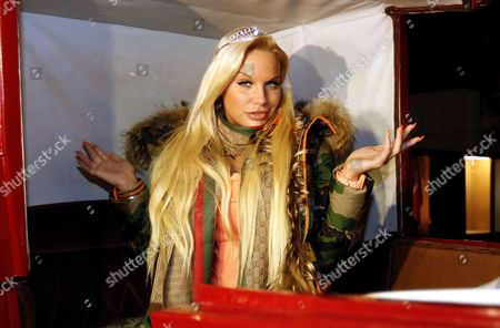 German Model Gina-lisa Lohfink Poses For a Photograph in a Traditional Fiaker Horse Carriage During a Press Event in Vienna Austria 06 December 2011 Austria Vienna