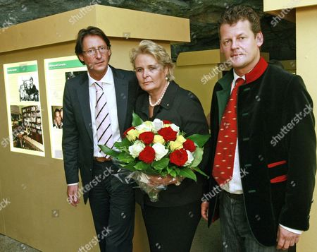 Joerg Haider's Widow Claudia (c) Poses with Bzoe Chairman Josef Bucher (l) and Klagenfurt's Mayor Christian Scheider (r) During the Opening of the Special Exhibition 'Joerg Haider 1950-2008' at the 'Bergbaumuseum' in Klagenfurt Austria 09 October 2009 the Exhibition is Held in Memorial of Late Leader of the Alliance For the Future of Austria Party (bzoe) and Governor Joerg Haider's First Death Anniversary Austria Klagenfurt