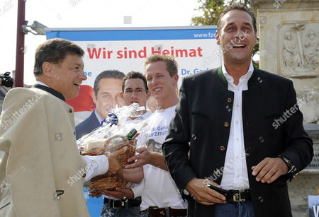 Stock Image of Leading Candidate of Austrian Freedom Party (fpoe) For Regional Elections in Styria Gerhard Kurzmann (l) and Party Leader Heinz-christian Strache (r) During a Campaign Rally in Weiz Austria 24 September 2010 Austria Weiz