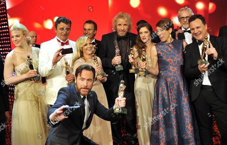 (l-r) Larissa Marolt (special Romy) Hans Sigl (most Popular Actor in Tv Series) Helene Fischer (most Popular Showstar) Thomas Gottschalk (honorary Award in Appreciation of a Life's Career) Miriam Stein (most Popular Actress) Adele Neuhauser (most Popular Actress in Tv Series) Guido Maria Kretschmer (most Popular Moderator Male) Pose with Their Trophies Behind Michael 'Bully' Herbig (best Movie) at the Romy Awards 2014 Gala at the Hofburg Palace in Vienna Austria 26 April 2014 the Romy Award is Austria's Movie and Television Award Named After Late Austrian Actress Romy Schneider (1938-1982) Austria Vienna