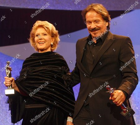 Austrian Actress Christiane Hoerbiger (l) and German Actor Goetz George (r) Smile After Receiving the Platinum Honorary Award in Appreciation of a Life's Career During the Romy Gala 2009 in Vienna's Hofburg Austria 25 April 2009 Austria Vienna