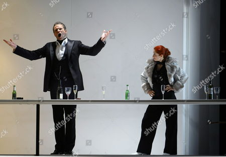 A Picture Dated 25 July 2009 Shows Danish Baritone Bo Skovhus (l) As 'Don Alfonso' and French Soprano As 'Despina' Performing During a Photo Rehearsal of Wolfgang a Mozart's 'Cosi Fan Tutte' in Salzburg Austria the Opera Premieres on 30 July at the House For Mozart As Part of the 2009 Salzburg Festival Austria Salzburg