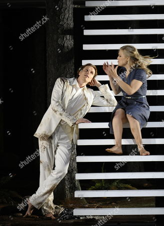 A Picture Dated 25 July 2009 Shows Finnish Tenor Topi Lehtipuu (l) As 'Ferrando' and Swedish Soprano Miah Persson As 'Fiordiligi' Performing During a Photo Rehearsal of Wolfgang a Mozart's 'Cosi Fan Tutte' in Salzburg Austria the Opera Premieres on 30 July at the House For Mozart As Part of the 2009 Salzburg Festival Austria Salzburg