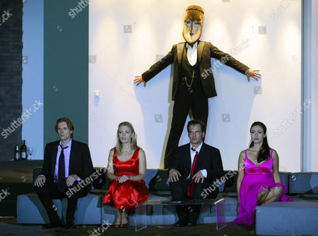 A Picture Dated 25 July 2009 Shows (l-r) Finnish Tenor Topi Lehtipuu As 'Ferrando' Swedish Soprano Miah Persson As 'Fiordiligi' Danish Baritone Bo Skovhus As 'Don Alfonso' Austrian Baritone Florian Boesch As 'Guglielmo' and Us Mezzo-soprano Isabel Leonard As 'Dorabella' Performing During a Photo Rehearsal of Wolfgang a Mozart's 'Cosi Fan Tutte' in Salzburg Austria the Opera Premieres on 30 July at the House For Mozart As Part of the 2009 Salzburg Festival Austria Salzburg