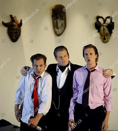A Picture Dated 25 July 2009 Shows (l-r) Danish Baritone Bo Skovhus As 'Don Alfonso' Austrian Baritone Florian Boesch As 'Guglielmo' and Finnish Tenor Topi Lehtipuu As 'Ferrando' Performing During a Photo Rehearsal of Wolfgang a Mozart's 'Cosi Fan Tutte' in Salzburg Austria the Opera Premieres on 30 July at the House For Mozart As Part of the 2009 Salzburg Festival Austria Salzburg