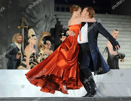 Austrian Actor Nicholas Ofczarek (r) and Austrian Singer and Actress Birgit Minichmayr (l) During the Rehearsal For the Play 'Jedermann' (everyman) of Hugo Von Hofmannsthal on 24 July 2011 in Salzburg Austria Each Summer the Front of the Salzburg Cathedral Serves As the Backdrop For the Salzburg Festival's Most Famous Play Hugo Von Hofmannsthal's Jedermann Which Will Premiere on 27 July Austria Salzburg