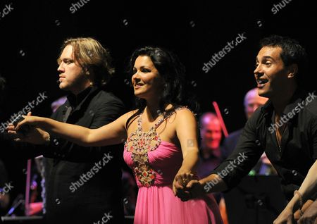 (l-r) Austrian Actor Nicholas Ofczarek Russian Soprano Anna Netrebko and Her Husband Uruguayan Baritone Erwin Schrott Acknowledge Applause at the End of the Benefit Concert For the Victims of the Pakistan Floods at the House For Mozart During the Salzburg Festival 2010 in Salzburg Austria 26 August 2010 All the Benefits Will Be Donated to the Initiative 'Nachbar in Not' Austria Salzburg