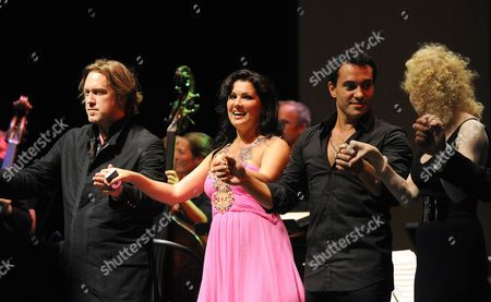 (l-r) Austrian Actor Nicholas Ofczarek Russian Soprano Anna Netrebko Her Husband Uruguayan Baritone Erwin Schrott and German Actress Sunnyi Melles Acknowledge Applause at the End of the Benefit Concert For the Victims of the Pakistan Floods at the House For Mozart During the Salzburg Festival 2010 in Salzburg Austria 26 August 2010 All the Benefits Will Be Donated to the Initiative 'Nachbar in Not' Austria Salzburg