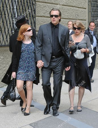 Austrian Actor Nicholas Ofczarek Accompanied by His Wife Austrian Actress Tamara Metelka (r) and Daughter (l) Arrive at the Official Opening of the Salzburg Festival at the Grosses Festspielhaus in Salzburg Austria 26 July 2010 the Festival Runs Until 30 August Austria Salzburg