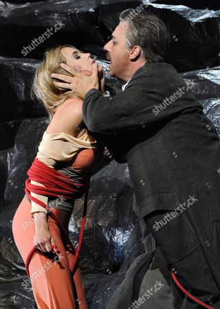 A Picture Dated 23 July 2010 Shows German Baritone Johannes Martin Kraenzle (r) and German Soprano Mojca Erdmann Performing During the Photo Rehearsal of the Opera 'Dionysus' in Salzburg Austria the Opera by Wolfgang Rihm Will Premiere at the Haus Fuer Mozart on 27 July As Part of the Salzburg Festival That Runs From 25 July to 30 August Austria Salzburg