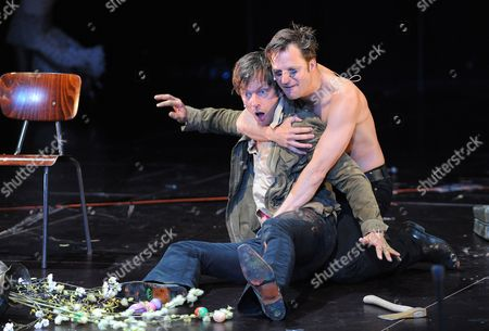 German Actor Sebastian Rudolph (l) and Austrian Actor Philipp Hochmair Perform During Photo Rehearsals For Johann Wolfgang Von Goethe's 'Faust i and Ii' on the Perner-insel (perner-island) at Hallein Austria 25 July 2011 the Production by German Theatre Director Nicolas Stemann is to Be Premiered As Part of the Salzburg Festival on 28 July the Festival Takes Place From 27 July to 30 August Austria Hallein