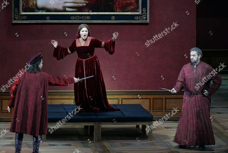 Russian Soprano Anna Netrebko (c) As Leonora Spanish Tenor Placido Domingo (r) As Count Di Luna and Italian Tenor Francesco Meli (l) As Manrico Perform During the Rehearsal of 'Il Trovatore' (the Troubadour) at the Grosses Festspielhaus (large Festival Hall) in Salzburg Austria 04 August 2014 the Opera Will Premiere on 09 August As Part of the Salzburg Festival That Runs From 18 July to 31 August Austria Salzburg