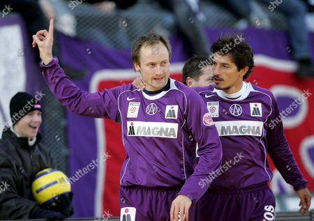 Austria Vienna's Sigurd Rushfeldt (l) and Ivica Vastic Celebrate After Rushfeldt Scored 1-0 During Their Austrian Bundesliga Match Austria Vienna Vs Rapid Vienna in Vienna on Sunday 13 March 2005 Austria Vienna