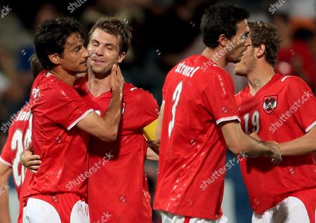 Austria's Players From L-r Ivica Vastic Andreas Ivanschitz and Martin Stranzl Celebrate After Beating Malta 5-1 30 May 2008 During the Friendly Soccer Match Austria Vs Malta in Graz Austria 30 May 2008 Austria Graz