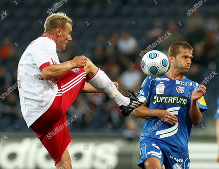 Red Bulls Alexander Zickler (l) Challenges For the Ball with Kapfenberg Superfund's Patrik Siegl During the Austrian Bundesliga Soccer Match Between Red Bull Salzburg and Kapfenberg Superfund in Salzburg Austria on 29 August 2009 Austria Salzburg