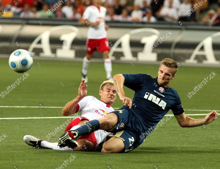 Igor Biscan (r) of Dinamo Zagreb Challenges For the Ball with Alexander Zickler (l) of Red Bull Salzburg During Their Champions League Qualification Soccer Match in Salzburg Austria on 29 July 2009 Austria Salzburg