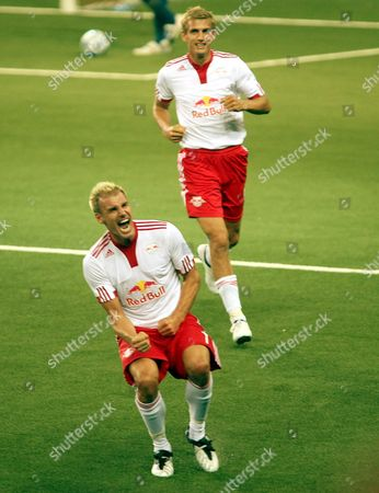 Alexander Zickler (l) of Red Bull Salzburg Celebrates Scoring Against Dinamo Zagreb During Their Champions League Qualification Soccer Match in Salzburg Austria on 29 July 2009 Austria Salzburg