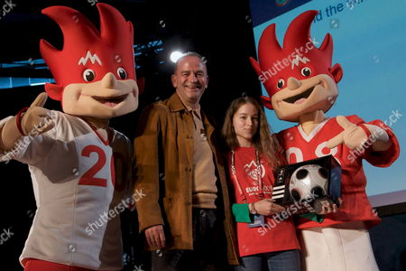 Stock Picture of Austrian Soccer Legend Herbert Prohaska (2nd L) and a Young Volunteer For the Euro 2008 Pose with Mascots Trix (l) and Flix (r) During the 'Volunteer Kick-off' at the Dusika Stadium in Vienna 19 April 2008 Eight Kick-off Events Will Mark the Start of Uefa Euro 2008 For the 5 000 Volunteers who Will Be Involved in the Tournament in Each Host City the 500 Volunteers Or 1 000 in the Case of Vienna and Basel Will Be Invited to an Evening of Events So That They Can Get to Know Their Euro Team Under the Tournament Slogan 'Expect Emotions' Participants Can Look Forward to a Programme That Includes Information Film Contributions Guest Speakers and a First Look at the Exclusive Volunteer Uniform All of Which is Designed to Get Them in the Mood For the Big Event Austria Vienna
