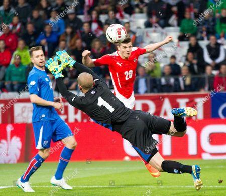Iceland's Goalkeeper Hannes Por Halldorsson (c) in Action Against Austria's Marcel Sabitzer (r) During the Friendly Soccer Match Between Austria and Iceland at Tivoli Stadium in Innsbruck Austria 30 May 2014 Austria Innsbruck