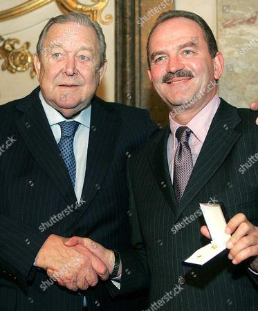 Austrian Soccer Legend Herbert Prohaska (r) is Awarded As 'Golden Player' by Uefa President Lennart Johansson (l) in Vienna Wednesday 10 November 2004 Austria Vienna