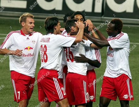 Red Bull Salzburg Players; Alexander Zickler Rene Aufhauser Anis Boussaidi Robin Nelisse Ibrahim Sekagya and Somen Tchoyi Celebrate Scoring the First Goal Against Fc Bananz During Their Uefa-cup Qualification Soccer Match Played in Salzburg Austria 17 July 2008 Austria Salzburg