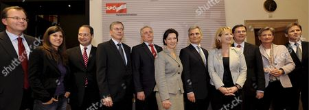 (l-r) Austrian Social Democrats Spoe Secretary Generals Guenther Kraeuter and Laura Rudas State Secretary Andreas Schieder Health Minister Alois Stoeger Secretary For Social Welfare Rudolf Hundstorfer Minister For Women Gabriele Heinisch-hosek Federal Chancellor Werner Faymann Minister For Infrastructure Doris Bures Defence Minister Norbert Darabos Minister For Education Claudia Schmied and State Secretary Josef Oestermayer Pose For a Picture After a Spoe Parliamentary Faction Meeting at the Parliament in Vienna Austria on 24 November 2008 Austria Vienna