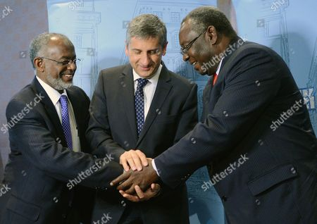 The Foreign Minister of Sudan Ali Karti Austrian Foreign Minister Michael Spindelegger (centre) and the Vice Foreign Minister of South Sudan Elias Nyamlell Wakoson(right) After the Conference on the Issue 'Sudan and Europe' in Vienna Austria 10 October 2012 Austria Vienna