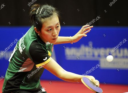 Ying Han of Germany in Action Against Charlotte Carey of Wales During Their Women's Single's Competition Match at the Ettu European Table Tennis Championships in Schwechat Austria 11 October 2013 Austria Schwechat