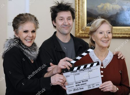 Austrian Actresses Maresa Hoerbiger (l) and Christiane Hoerbiger Pose with Director Sascha Bigler at a Photocall During the Filming of Their Television Movie 'Meine Schwester' in Vienna Austia 07 March 2011 Austria Vienna