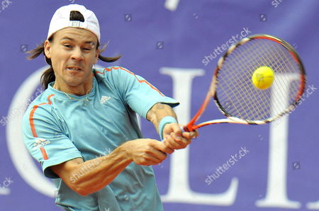 Stock Photo of Guillermo Coria From Argentina Returns the Ball to Austrian Alexander Peya During Their Match at the Austrian Open Tennis Tournament in Kitzbuehel Austria 15 July 2008 Austria Kitzbuehel