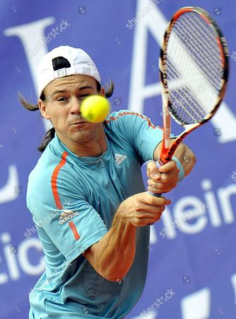 Stock Picture of Guillermo Coria From Argentina Returns the Ball to Austrian Alexander Peya During Their Match at the Austrian Open Tennis Tournament in Kitzbuehel Austria 15 July 2008 Austria Kitzbuehel