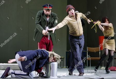 Juergen Maurer As 'Policeman' (2nd L) and the 'People' (from Left) Michael Wittenborn Nicholas Ofczarek and Regina Fritsch During the Dress Rehearsal For William Shakespeare's 'Measure For Measure' at the Burgtheater in Vienna 26 April 2007 the Premiere Will Be on 28 April 2007 Austria Vienna