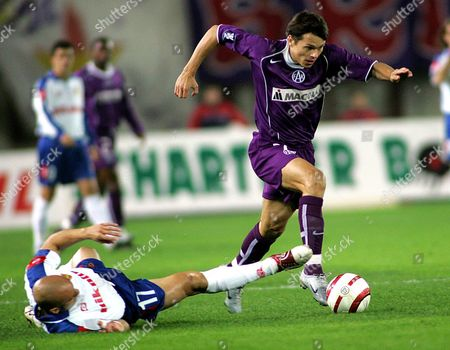 Epa000307391 Austria Vienna Player Libor Sionko (r) Challenges For the Ball with Real Saragossa's Player Maria Movilla (l) During Their Uefa Cup Group C Soccer Match at the Ernst Happel Stadium in Vienna Thursday 04 November 2004 Austria Vienna