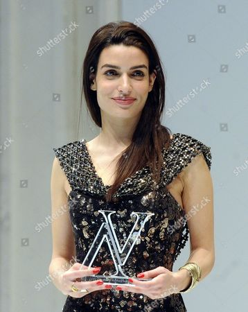 Greek Actress Tonia Sotiropoulou Smiles While Presenting an Award Onstage During the Vienna Awards For Lifestyle and Fashion Ceremony in Vienna Austria 21 March 2013 Austria Vienna
